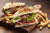 image of tomato sandwich  - ham and bacon club sandwich on a white background - JPG