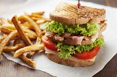 pic of tomato sandwich  - ham and bacon club sandwich on a white background - JPG
