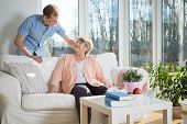 foto of nursing  - Male nurse caring about patient at home - JPG