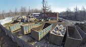 picture of junk-yard  - Aerial view of the trash containers on the one of yard - JPG