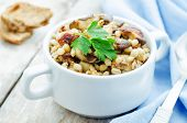 pic of porridge  - barley porridge with mushrooms on a white wood background - JPG