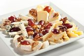 image of cheese platter  - Assorted Cheeses with Grapes and Nuts on Platter - JPG