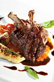 stock photo of lamb chops  - Roasted Lamb Chops on Tomato Sauce Garnished with Vegetables and Basil - JPG