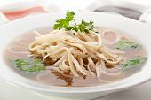 stock photo of rice noodles  - Beef Broth with Rice Noodle and Chili Sauce - JPG