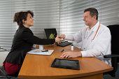 foto of prophylactic  - Woman Pharmaceutical Sales Representative meets a doctor  - JPG