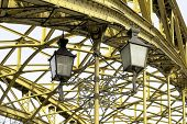 image of spreader  - Decorative lamps hanging from old bridge - JPG