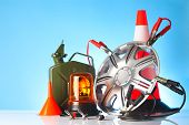 stock photo of rectifier  - car accessories and road emergency items on blue background - JPG