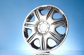 image of alloy  - shiny alloy wheel isolated  on blue background - JPG