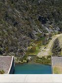 stock photo of dam  - Tooma Dam is a major ungated concrete embankment dam across the Tooma River in the Snowy Mountains of New South Wales in Australia - JPG