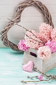stock photo of willow  - Background with fresh pink hyacinths in box and willow flowers and heart on turquoise painted wooden planks - JPG