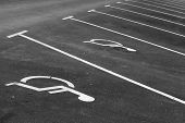 stock photo of handicap  - Empty parking places with handicapped or disabled signs and marking lines n asphalt - JPG