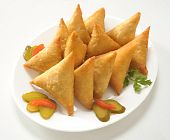 stock photo of samosa  - Triangle Potato Samosas filled with spicy potato filling - JPG