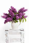 stock photo of wooden crate  - lilacs and lilies of the valley on a wooden crate  - JPG