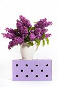 picture of wooden crate  - lilacs and lilies of the valley on a wooden crate  - JPG