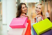 picture of mall  - Two beautiful young women enjoying shopping at shopping mall - JPG