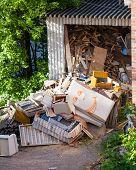 picture of junk-yard  - Funny broken furnitures trash pile at yard - JPG