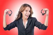 foto of white collar crime  - Female businesswoman with handcuffs on white - JPG