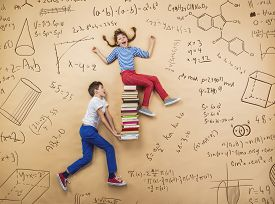 picture of big-girls  - Cute boy and girl learning playfully in frot of a big blackboard - JPG