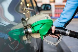 stock photo of gas-pipes  - Pumping gas at gas station - JPG