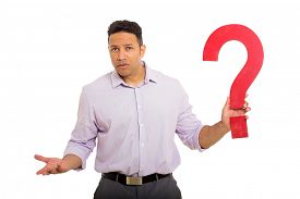 stock photo of confusing  - confused man holding question mark on white background - JPG