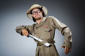 foto of hunter  - Funny safari hunter against background - JPG