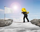 picture of mountain chain  - Businessman carrying golden euro sign balancing on rusty chain walking to white flag on cliff with sky clouds sun background - JPG