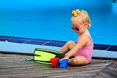 picture of flipper  - cute girl with flippers in swimming pool at tropical beach - JPG