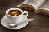 stock photo of continent  - Still life photography of hot coffee beverage with map of America continent - JPG