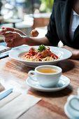 stock photo of meatball  - close up of woman eating spaghetti meatball - JPG