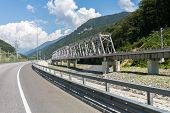 image of mountain chain  - highway and railway bridge over Mzymta River in the mountains - JPG