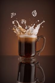 picture of cocktail menu  - Splash of  ice coffee drink on a brown background - JPG