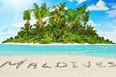 Whole Tropical Island Within Atoll In Tropical Ocean And Inscription maldives In The Sand On A Tro poster