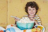 stock photo of televisor  - adorable child Watching TV in his home - JPG