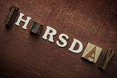 stock photo of thursday  - The word thursday written on wooden background - JPG