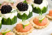 image of crudites  - Plate full of delicious party snacks with cucumber and salmon toast - JPG