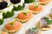 foto of crudites  - Delicious party snacks ready to be served and made up with salmon and fresh herring - JPG