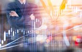 Business Man On Digital Stock Market Financial And Dart Background. Digital Business And Stock Marke poster