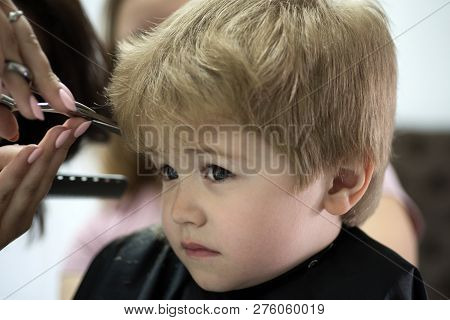 poster of Making Haircut Fun. Little Child Given Haircut. Small Child In Hairdressing Salon. Little Boy With B