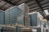 Warehouse Interior. Warehouse With Packed Glass Bottles. Spacious Illuminated Storage Room With Pack poster