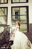 Small Girl Kid With Long Blonde Hair And Pretty Happy Smiling Face In Prom Princess White Dress With poster