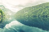 View Into Beautiful Mountain Lake Pass In Alps. Calm Lake Water And Sunny Weather, Lake Reflection poster