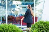 Cropped Image Traveler Tourist Woman Crossed In Summer Casual Clothes With Suitcase On Road In City  poster