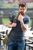 Looking For Accommodations. Hipster Thoughtful Traveler Carry Travel Bag. Business Trip. Man Bearded poster