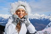 Winter woman portrait outdoors. Snow winter woman portrait outdoors on snowy white winter d poster
