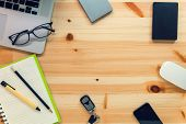 Top View Mockup On Empty Workspace Table Desktop, Modern Workspace With Notebook, Smartphone, Paper  poster