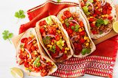 mexican beef and pork tacos with salsa, guacamole and vegetables poster