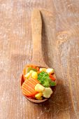 Cooked Carrots Sweet Corn And Broccoli In A Wooden Spoon poster