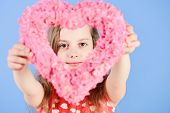 Girl Holding Blurred Pink Heart On Blue Background. Valentine And Valentines Day Celebration. Sweeth poster