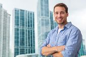 Happy young man businessman portrait young smiling confident in front of modern condo building skysc poster
