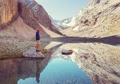 Beautiful serene lake in  Fanns mountains (branch of Pamir) in Tajikistan. poster